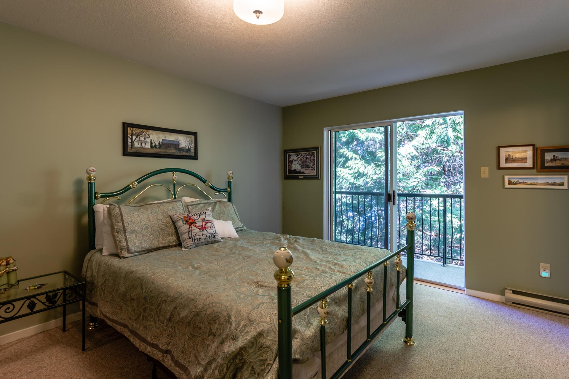 Upper Guest Suite Bedroom at 5101 Island Highway West, Qualicum Beach, Zone 05 - Parksville/Qualicum