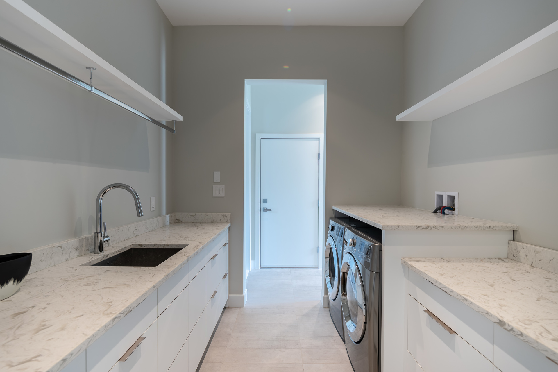Laundry Room & Hall To Above-Garage Suite at 5101 Jagtar's Way, Prospect Lake, Saanich West