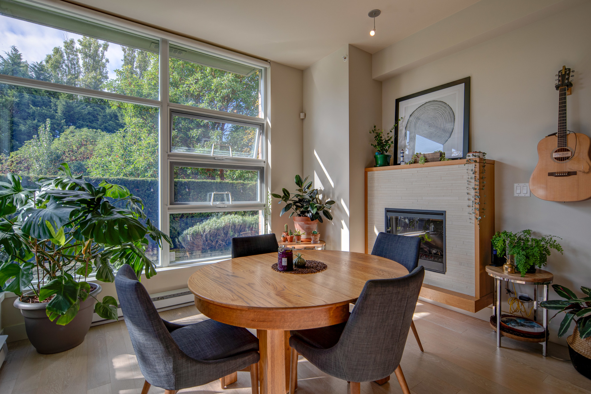 Dining Are With Gas Fireplace at 115 - 365 Waterfront Crescent, Rock Bay, Victoria