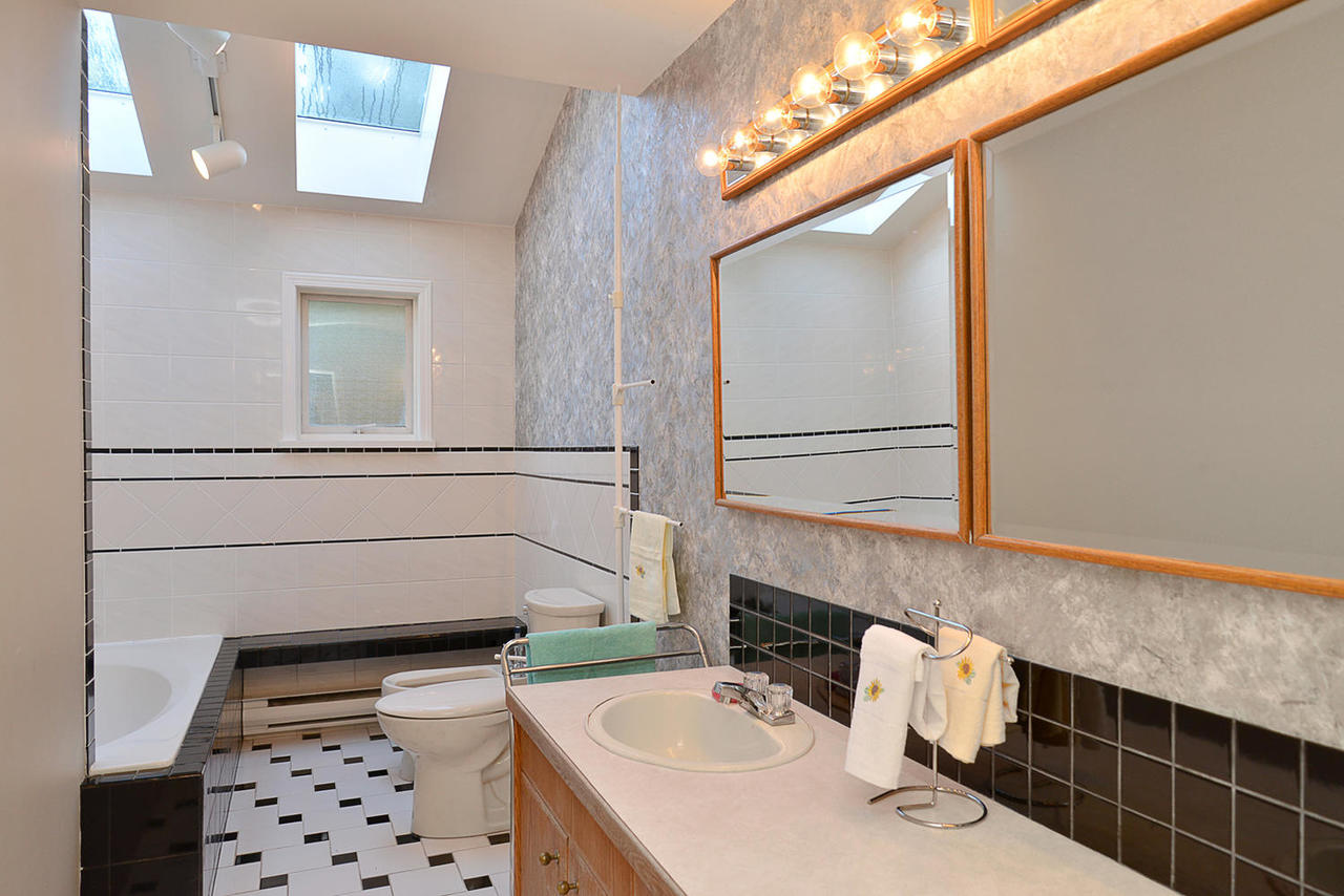 Main Bathroom with Huge Soaker Tub with dual Skylights at  , Sechelt District, Sunshine Coast