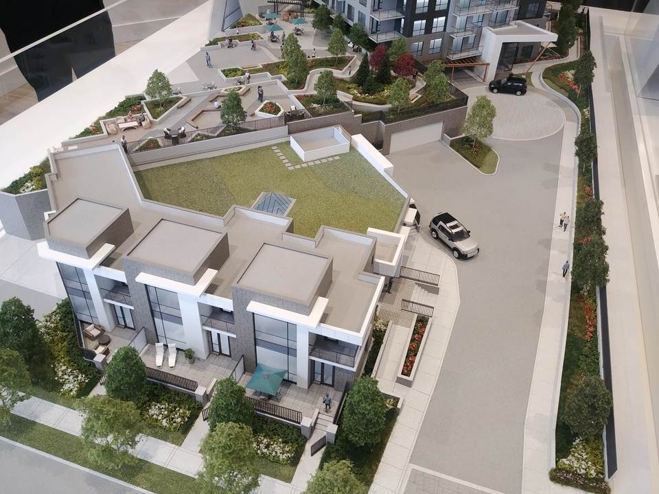 centra-entry-drive-with-townhomes-in-foreground-and-amenity-behind at Centra Surrey City Centre (13868 101 Avenue, Whalley, North Surrey)