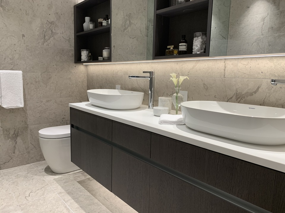 Voyce display ensuite with fully tiled marble walls and floor at Voyce ( Cambie Street, Cambie, Vancouver West)