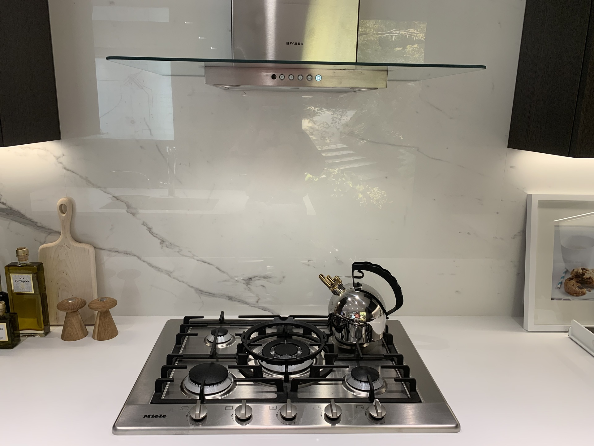 Voyce display hood fan and gas cooktop at Voyce ( Cambie Street, Cambie, Vancouver West)