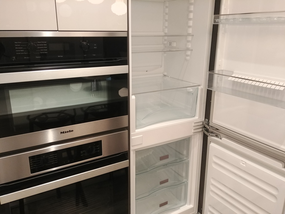 highline-junior-2-bed-b-plan-european-size-speed-oven-convection-and-fridge at Highline (6811 Sussex Street, Metrotown, Burnaby South)