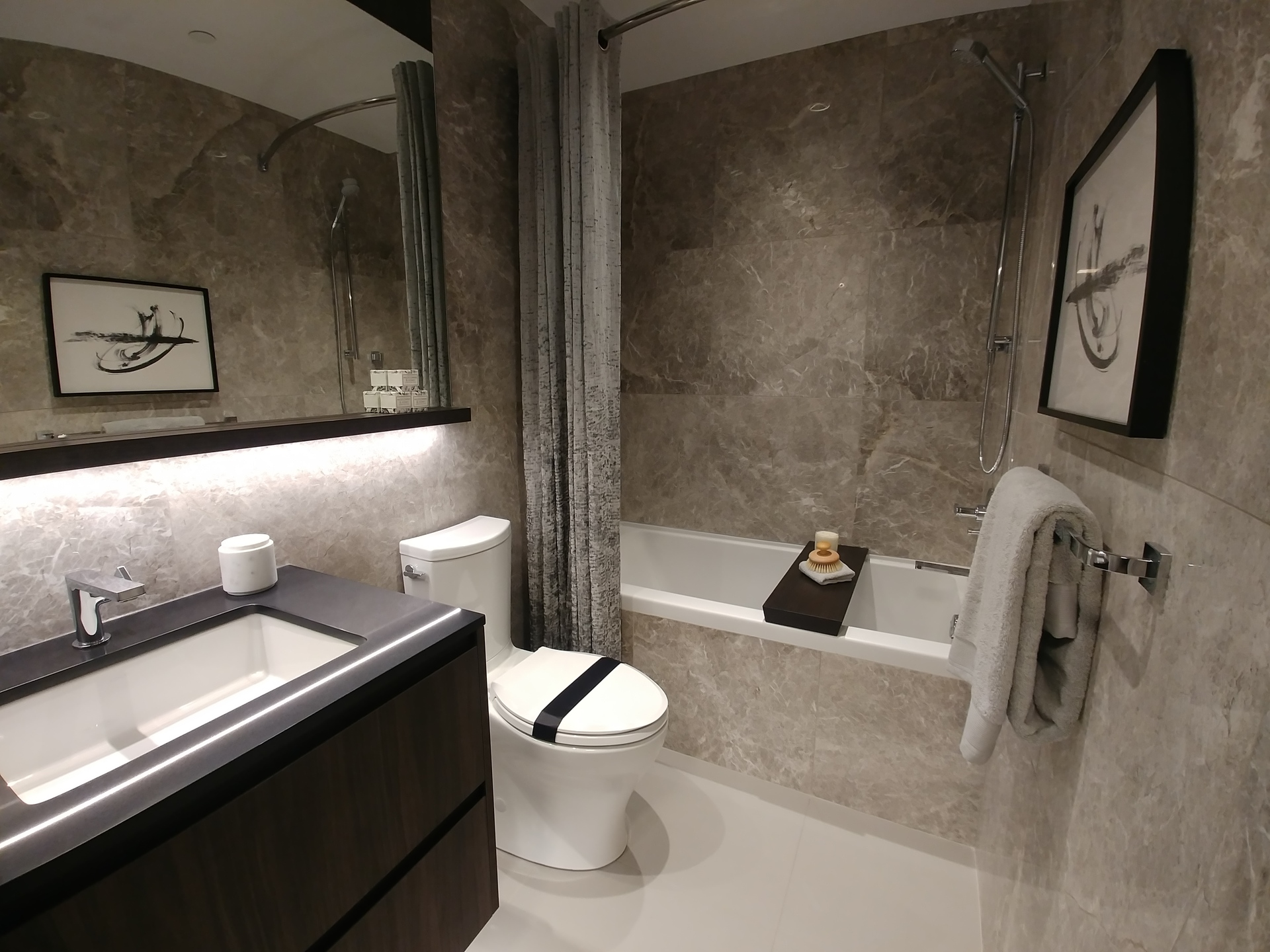 highline-main-bathroom-with-fully-tiled-walls-in-dark-scheme at Highline (6811 Sussex Street, Metrotown, Burnaby South)
