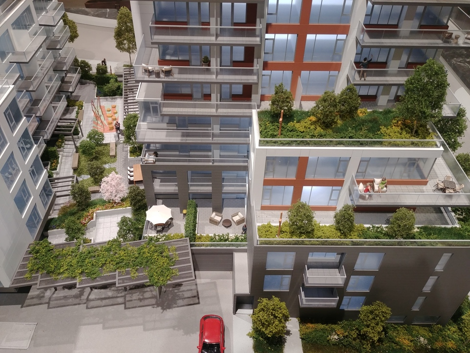 davie-nicola-north-facade-lower-floors-and-communal-amenity-terrace at Davie and Nicola (1188 Nicola, West End VW, Vancouver West)
