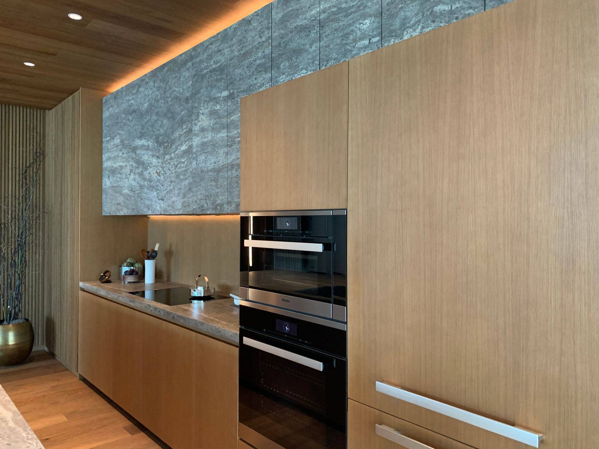 1515 dada molteni kitchen in natural with travertine upper cabinets at Fifteen Fifteen (1515 Alberni Street, Coal Harbour, Vancouver West)