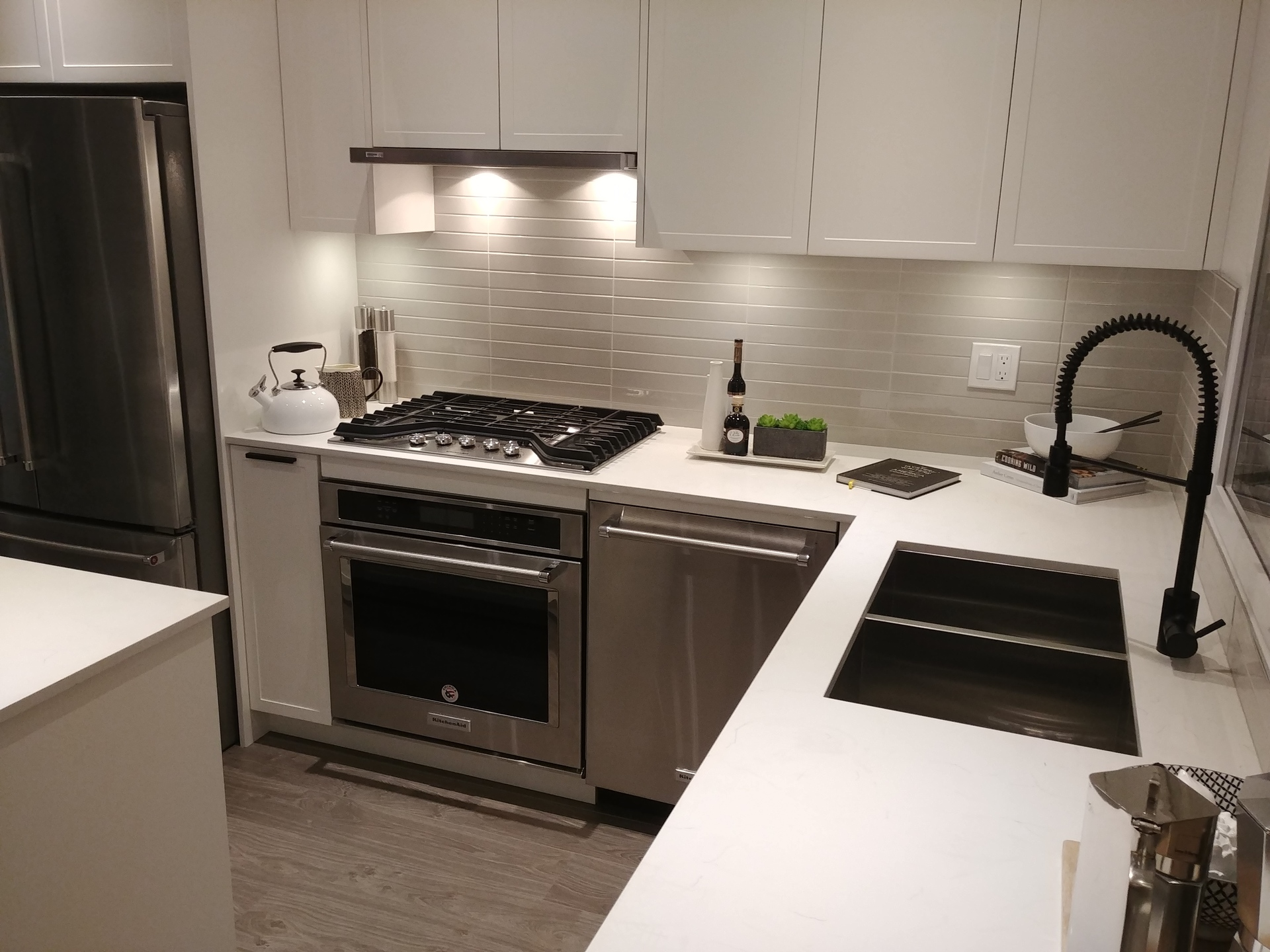 arcola-kitchen-display-with-kitchen-aid-appliances at Arcola Townhomes (6965 Arcola Street, Highgate, Burnaby South)