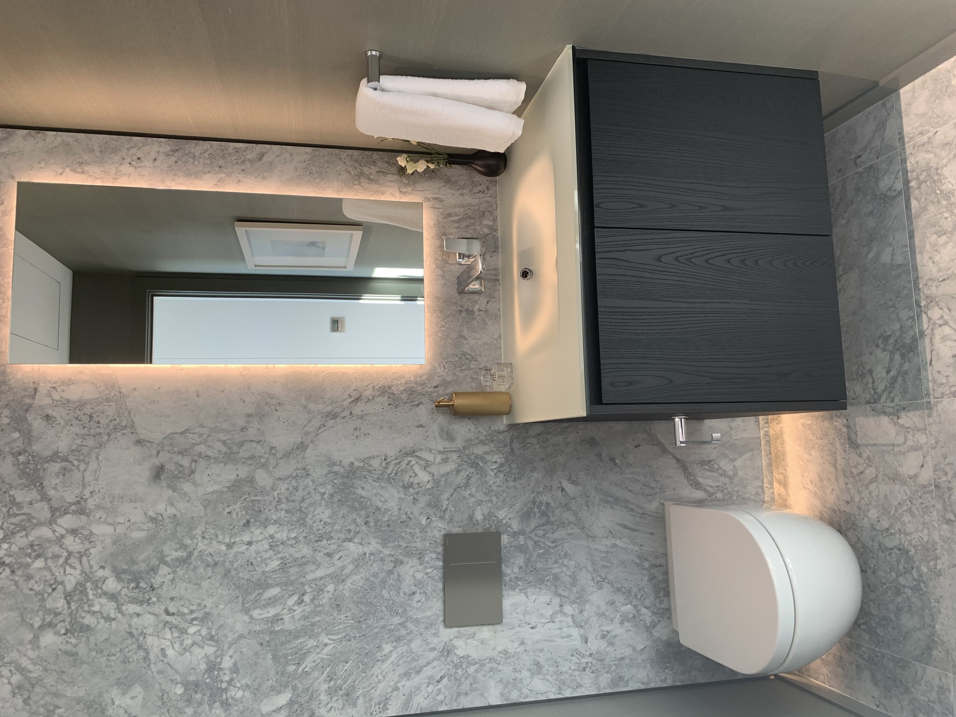Tesoro powder room with quartzite feature wall at TESORO 1551 Quebec - The Creek Building 5 (1551 Quebec, False Creek, Vancouver West)