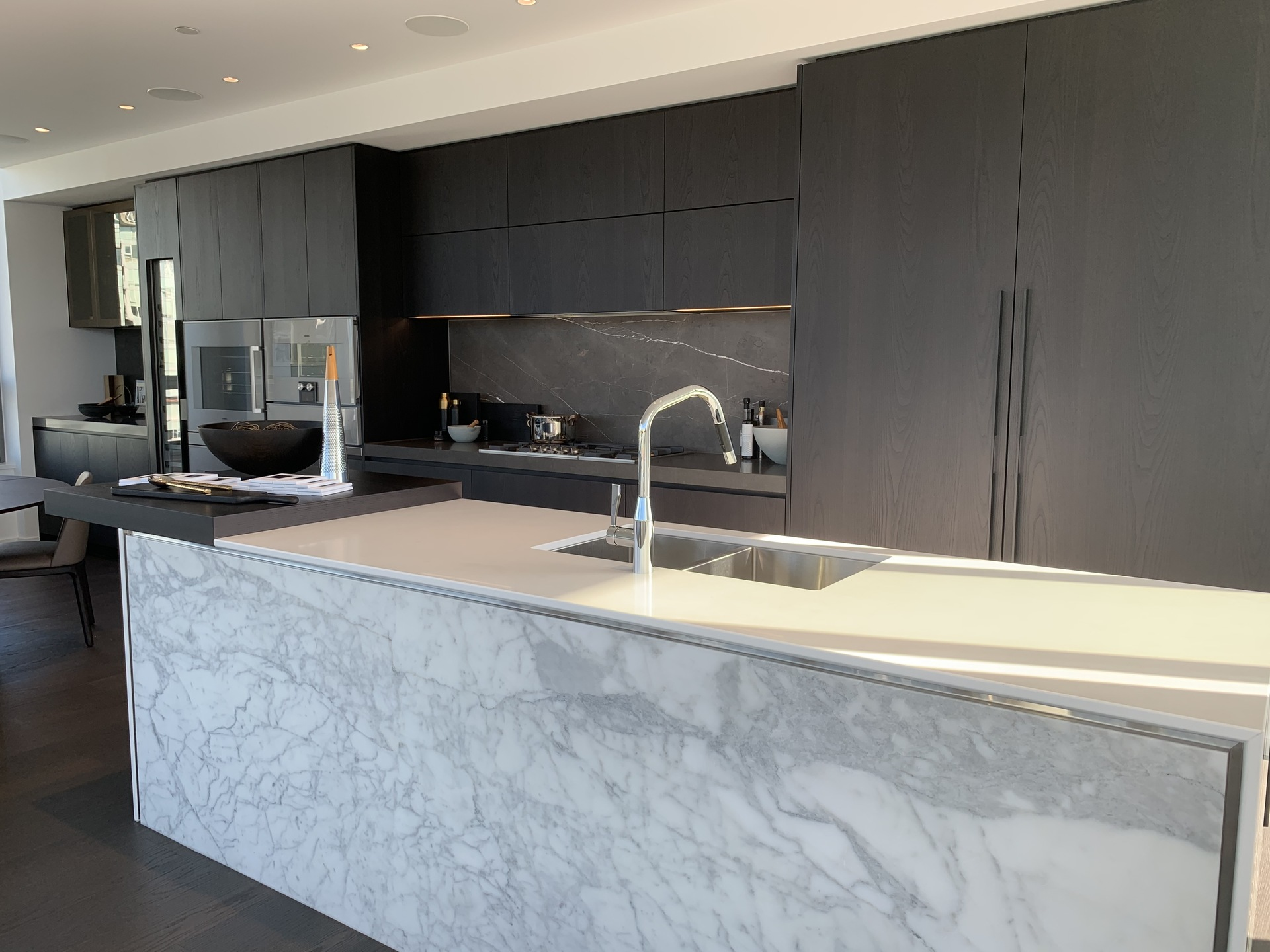 Tesoro kitchen with marble slab kitchen island at TESORO 1551 Quebec - The Creek Building 5 (1551 Quebec, False Creek, Vancouver West)