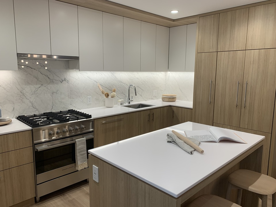 Kin - kitchen in light scheme at The Kin Collection (7470 Buller Avenue, Metrotown, Burnaby South)