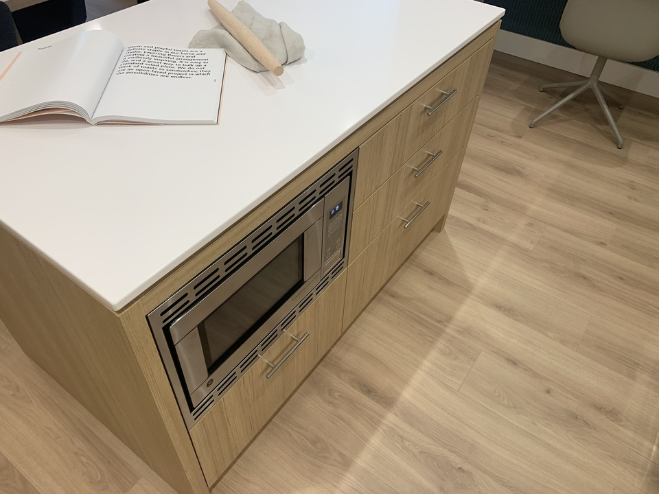 Kin - kitchen island with built-in microwave at The Kin Collection (7470 Buller Avenue, Metrotown, Burnaby South)