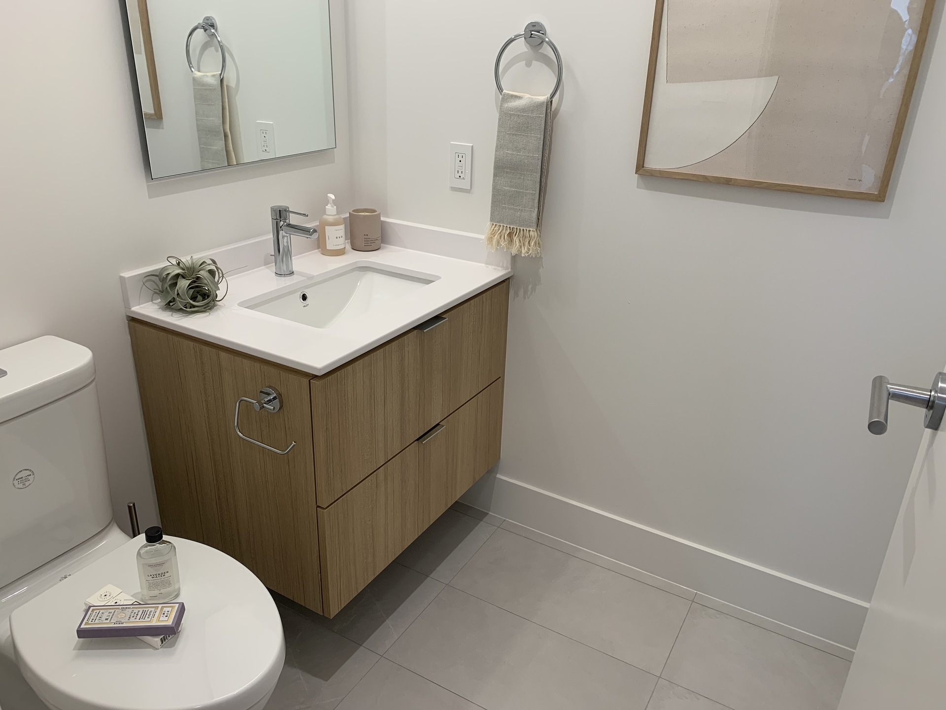 Kin - powder room on living level of City Home at The Kin Collection (7470 Buller Avenue, Metrotown, Burnaby South)