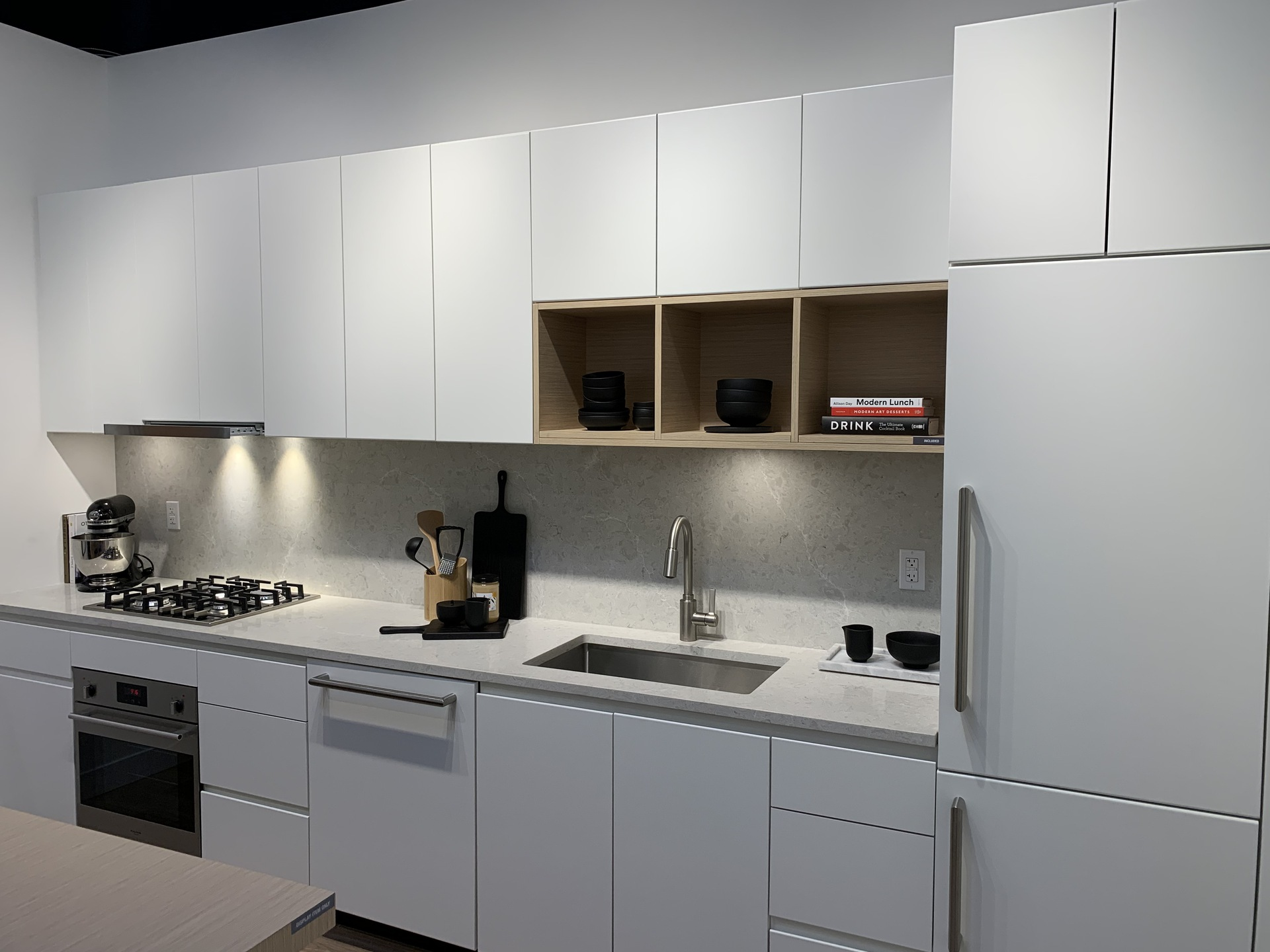 alaska-one-bed-linear-kitchen-in-white-colour-scheme at Alaska (4455 Alaska Street, Brentwood Park, Burnaby North)