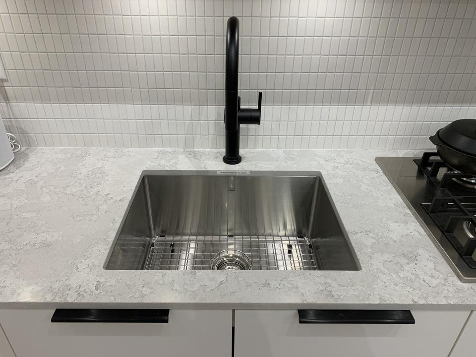 habitat-kitchen-with-matt-black-faucet-quartz-countertop-tile-backsplash at Habitat (2520 Guelph Street, Mount Pleasant VE, Vancouver East)