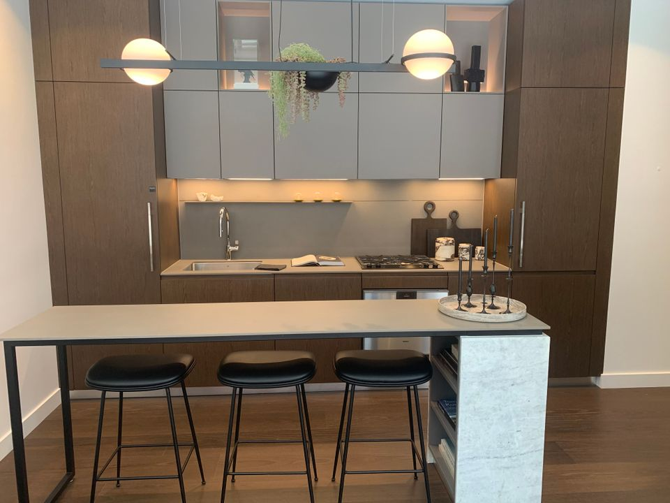 Kitchen in walnut colour scheme at Two Burrard Place (1223 Hornby Street, Downtown VW, Vancouver West)