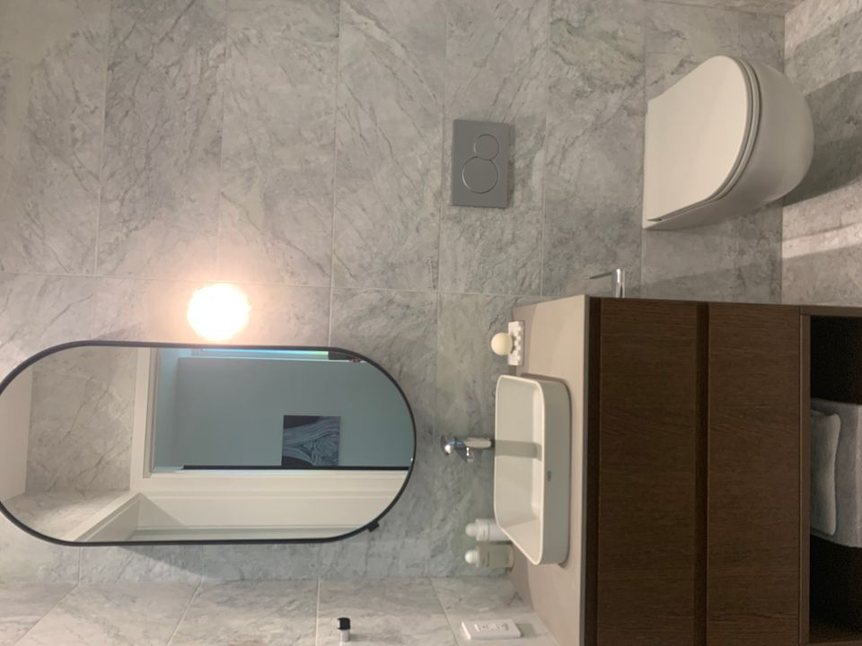 Main bathroom in walnut colour scheme at Two Burrard Place (1223 Hornby Street, Downtown VW, Vancouver West)