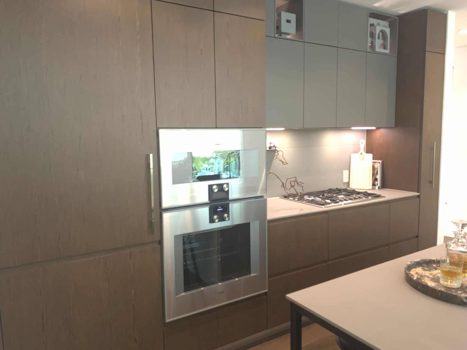 Kitchen in walnut scheme at Two Burrard Place (1223 Hornby Street, Downtown VW, Vancouver West)