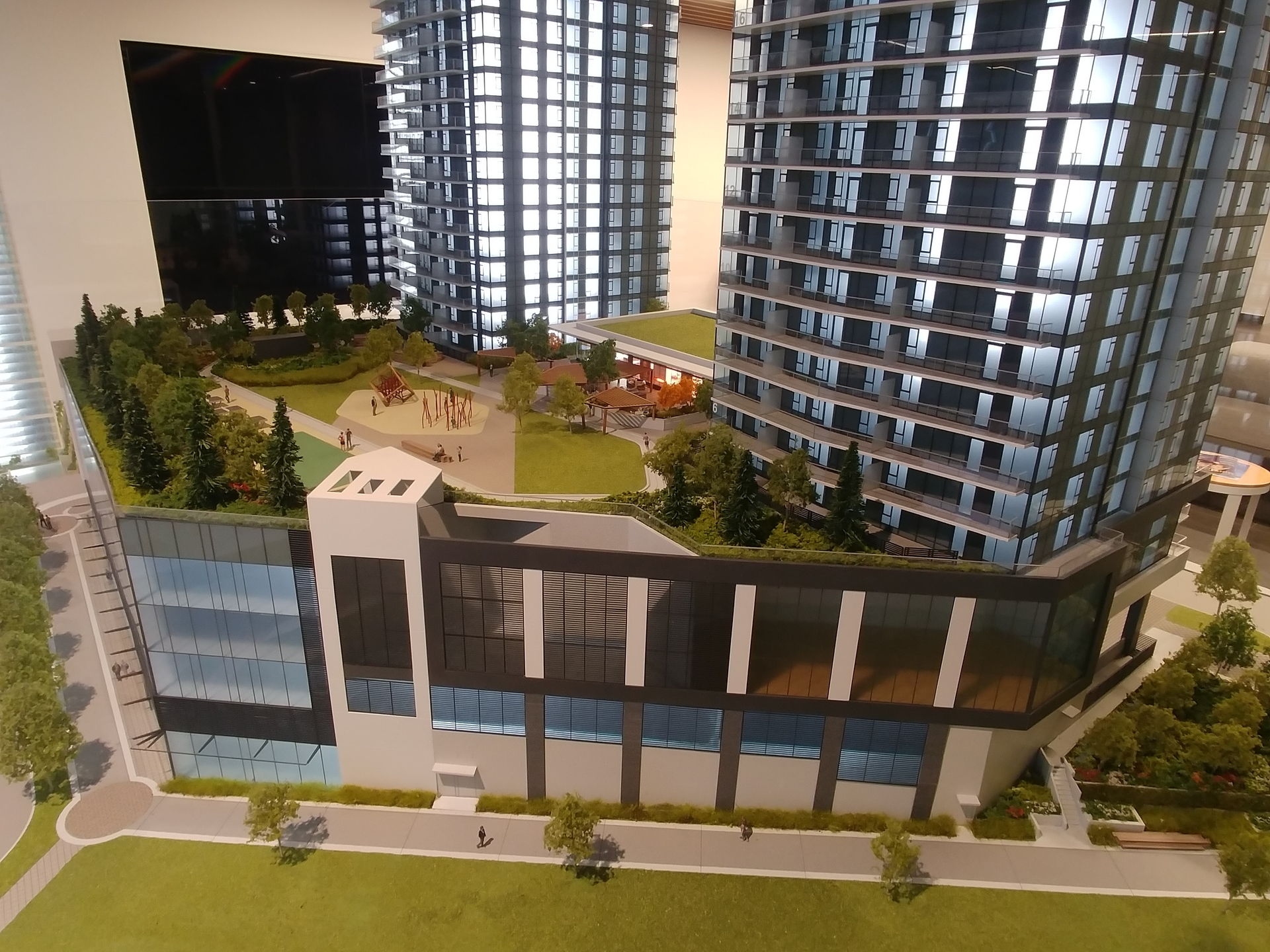 soco-sw-podium-showing-commercial-units-and-indoor-sports-court at SOCO (319 North Road, Coquitlam West, Coquitlam)