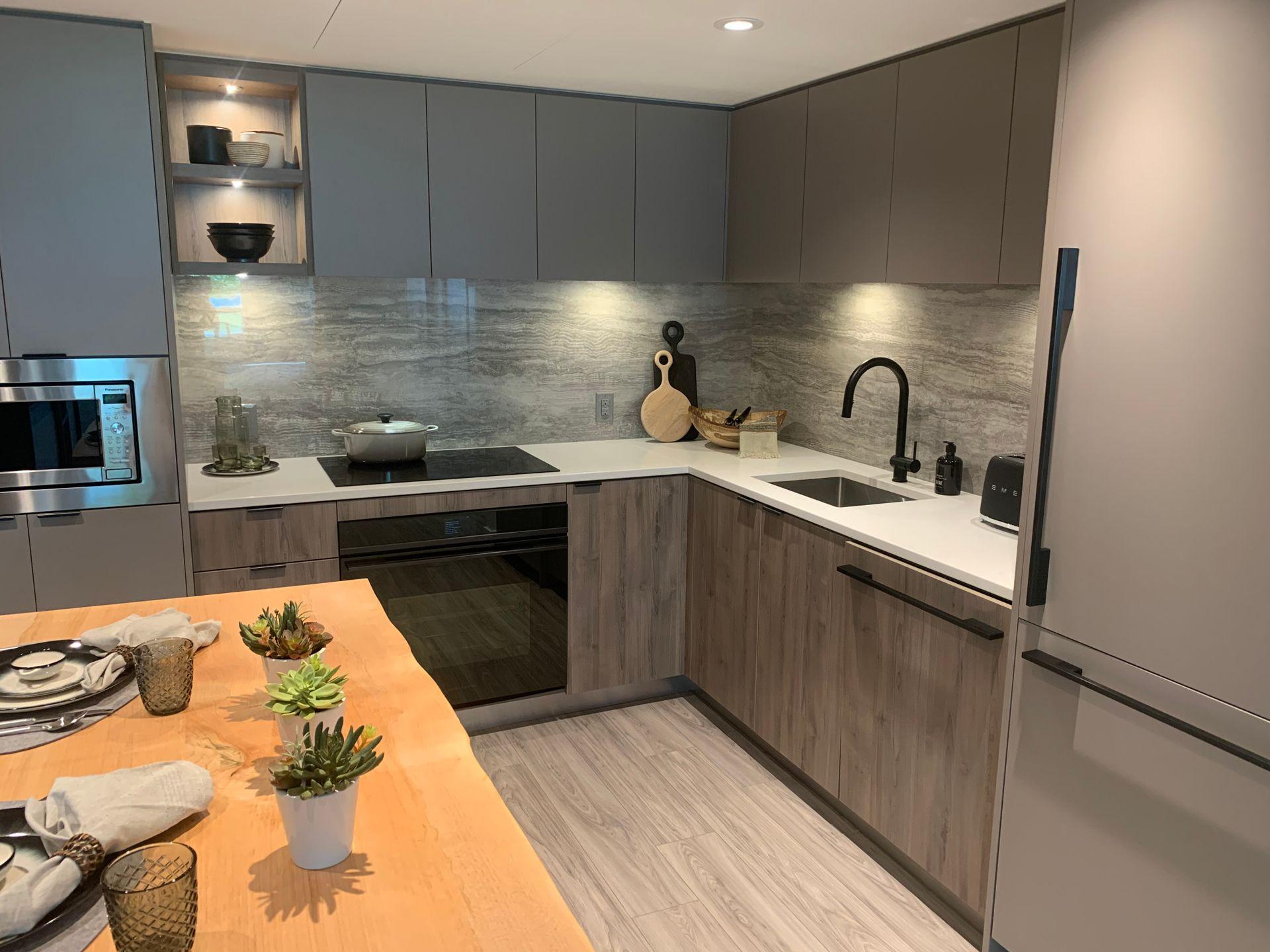 drift kitchen in dark scheme at Drift - North Harbour ( Harbourside Drive, Hamilton, North Vancouver)