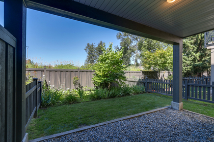 Fenced back yard with covered patio and grass at 55 - 8355 164 Street, Fleetwood Tynehead, Surrey
