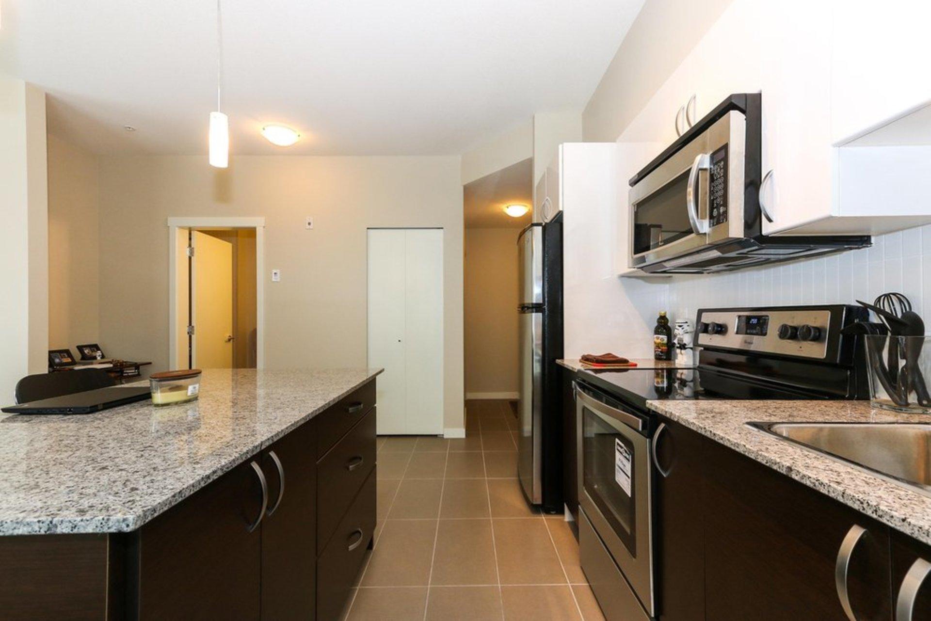 quattro-3-kitchen-1 at 209 - 13728 108 Avenue, Whalley, North Surrey