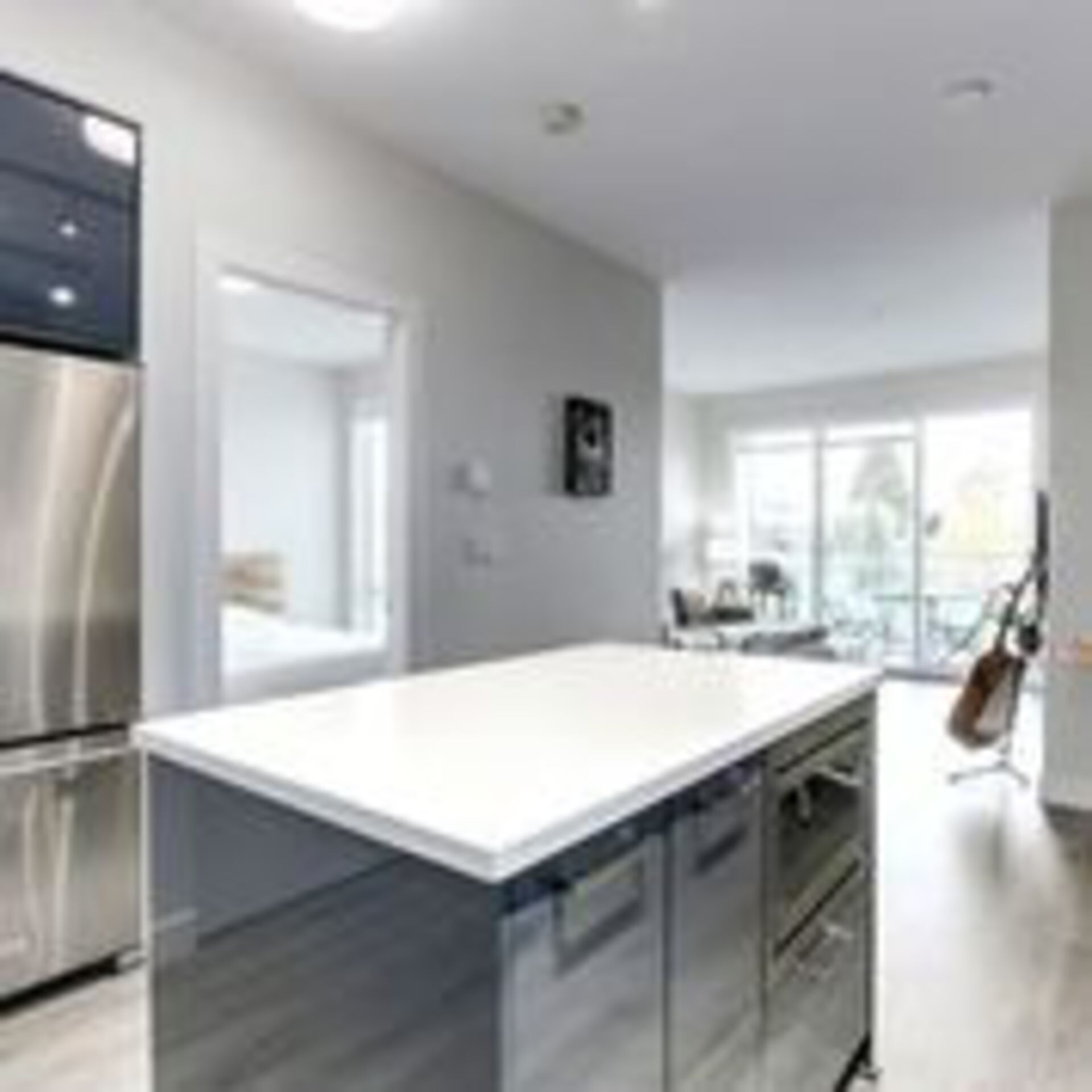 310-escala-kit-island-towards-bedroom at 310 - 1768 Gilmore Avenue, Brentwood Park, Burnaby North