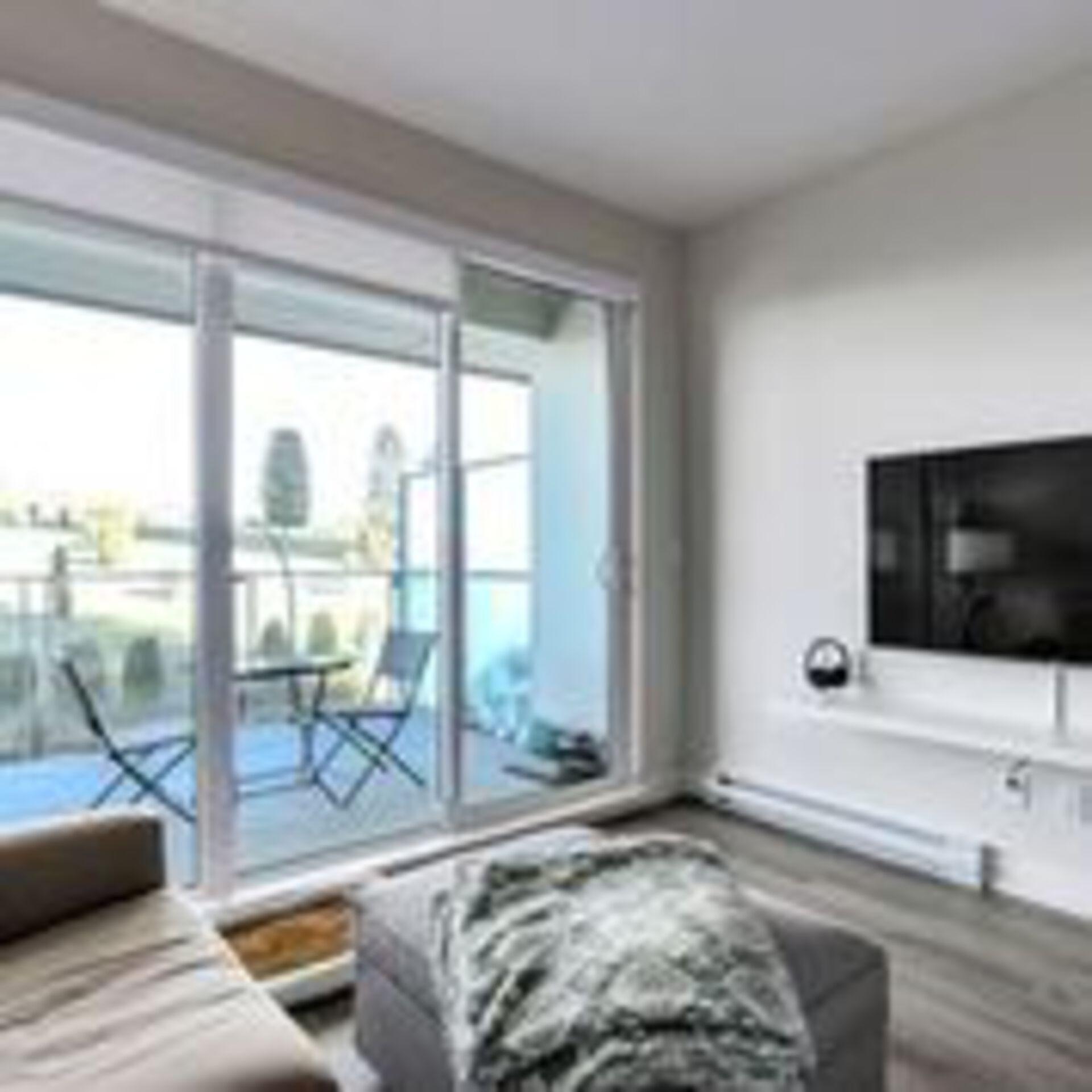 310-escala-living-towards-balcony-ne at 310 - 1768 Gilmore Avenue, Brentwood Park, Burnaby North