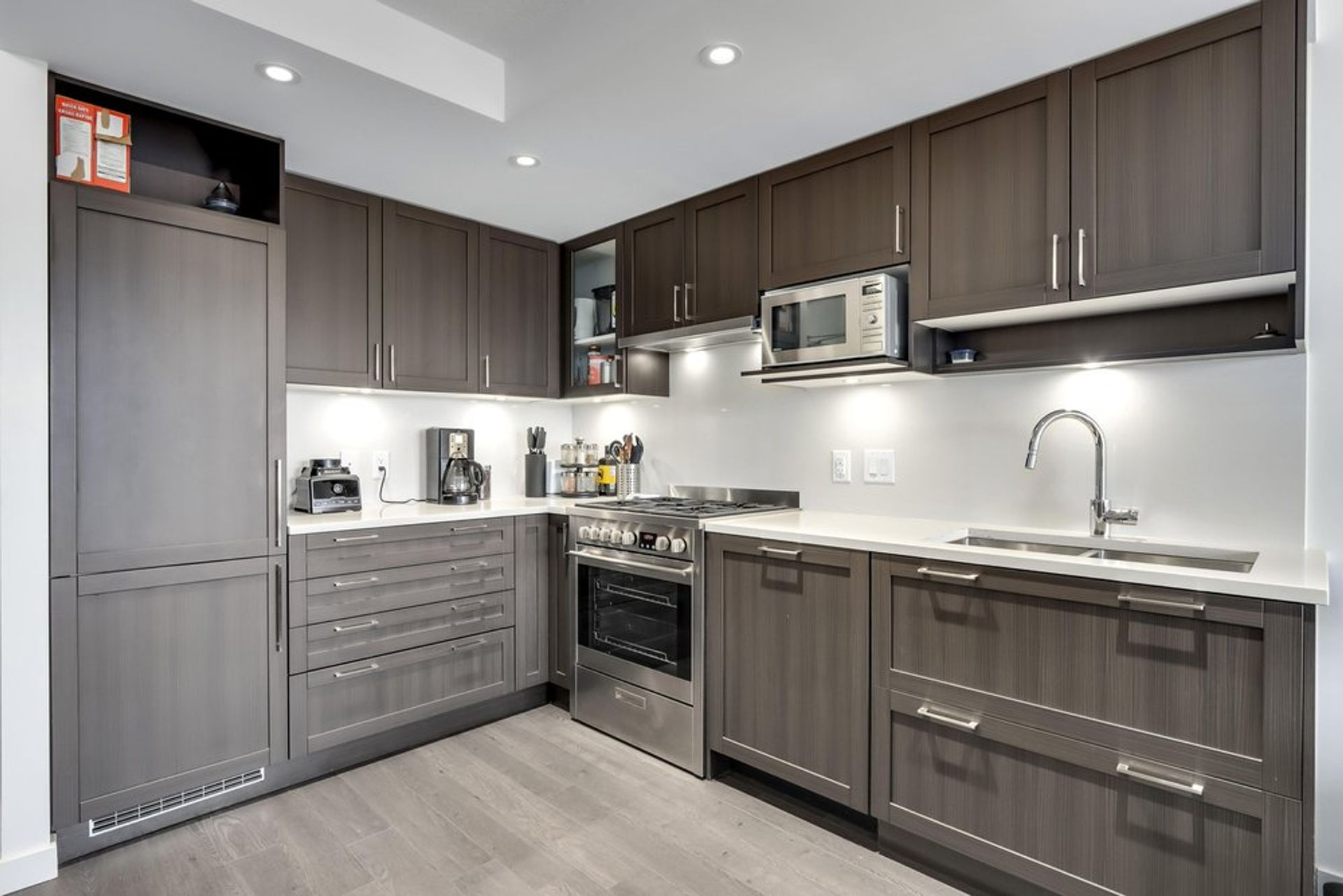 kitchen with integrated fridge and dishwasher at 1103 - 5470 Ormidale Street, Collingwood VE, Vancouver East