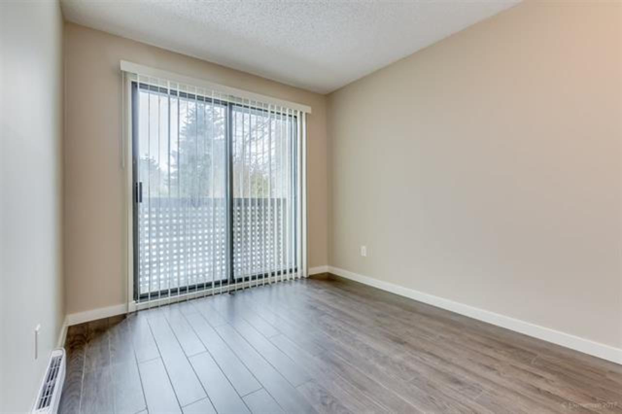 Bedroom w/ Private Balcony at 311 - 340 Ginger Drive, Fraserview NW, New Westminster