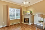 living-rm-w-fireplace at #106 - 15298 20 Avenue, King George Corridor, South Surrey White Rock