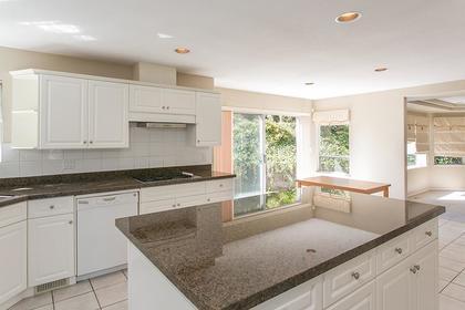 kitchen island & nook at 7589 Manzanita Place, Burnaby East