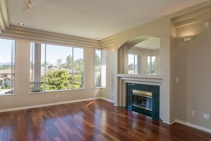 living room w fireplace & hardwood floor at 7589 Manzanita Place, Burnaby East