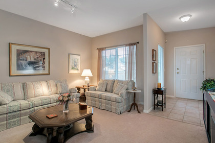 living room right tiled entry at #5 - 1751 Paddock Drive, Westwood Plateau, Coquitlam