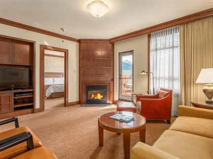 living-room-w-fireplace at #745 - 4591 Blackcomb Way, Benchlands, Whistler