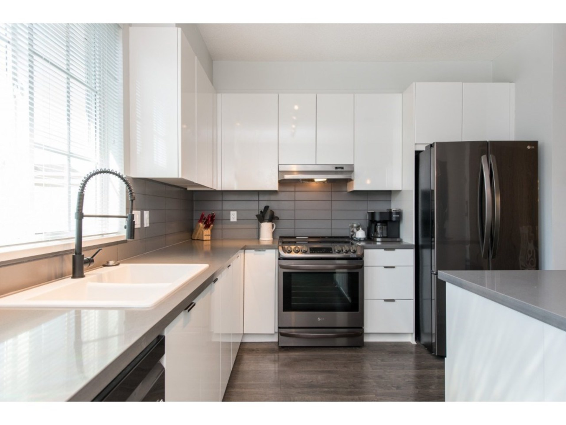 Kitchen with black stainless appliances at 94 - 30989 Westridge Place, Abbotsford West, Abbotsford