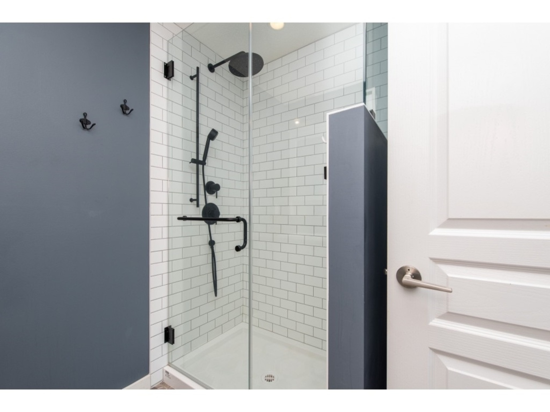 Ensuite shower with all new glass, tile and matte black fixtures at 94 - 30989 Westridge Place, Abbotsford West, Abbotsford