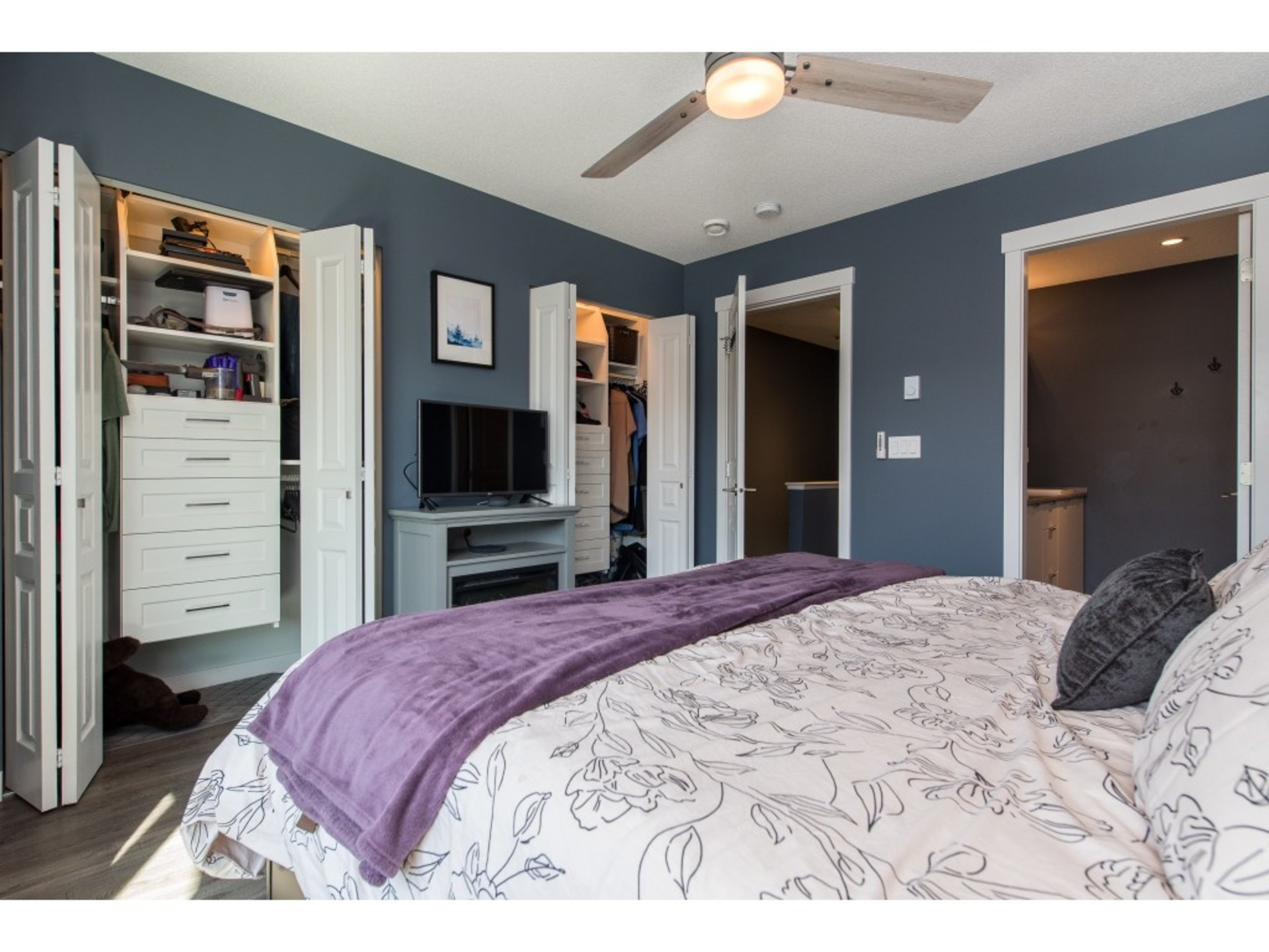 Master bedroom with double closets and upgraded custom closet organizers at 94 - 30989 Westridge Place, Abbotsford West, Abbotsford