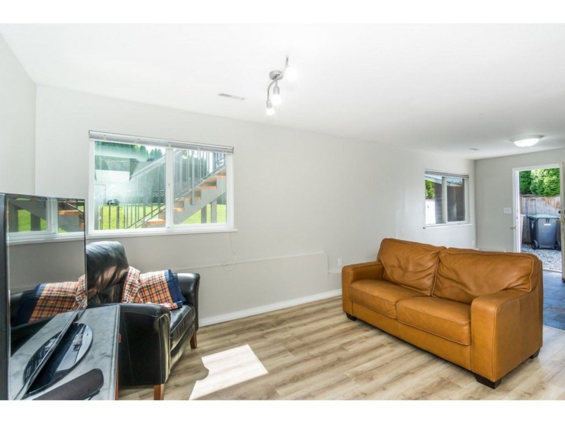 Downstairs Family Room with Exterior Door  at 21662 50a Avenue, Murrayville, Langley
