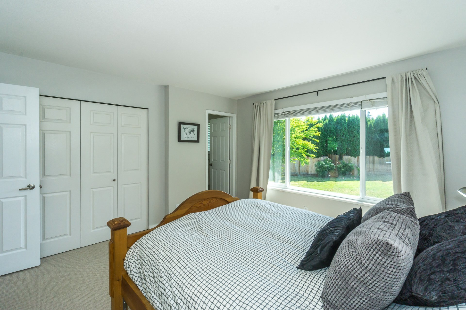 Master Bedroom looking towards Ensuite and Closet (check out the view of the backyard) at 21662 50a Avenue, Murrayville, Langley