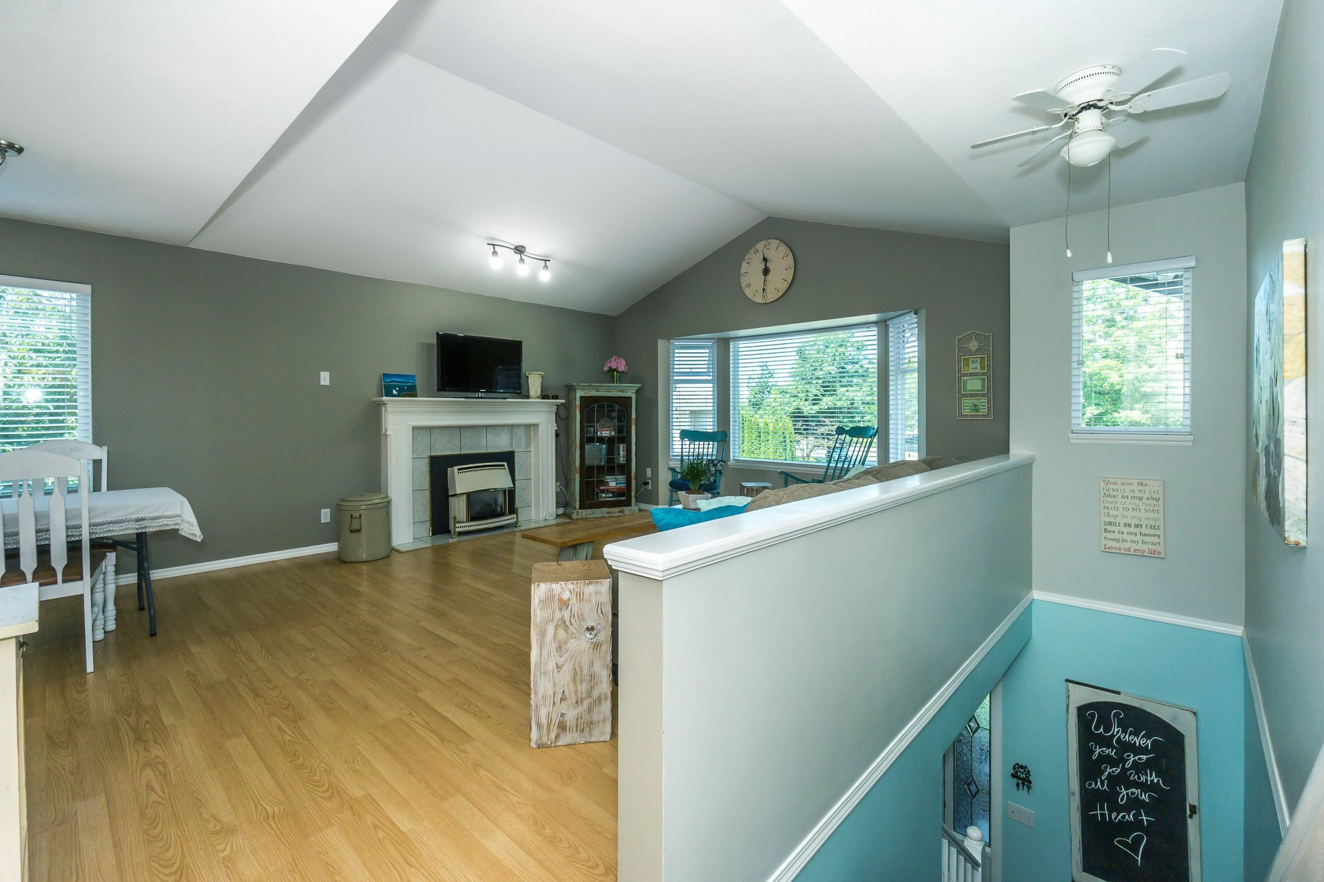 View of Living Room from Stairs at 21662 50a Avenue, Murrayville, Langley