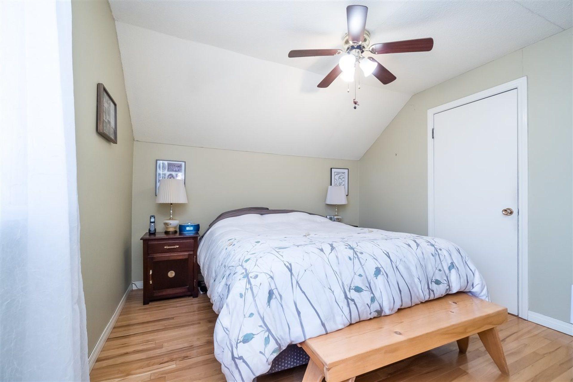 Master Bedroom showing door to walk in closet at 9941 121a Street, Cedar Hills, North Surrey