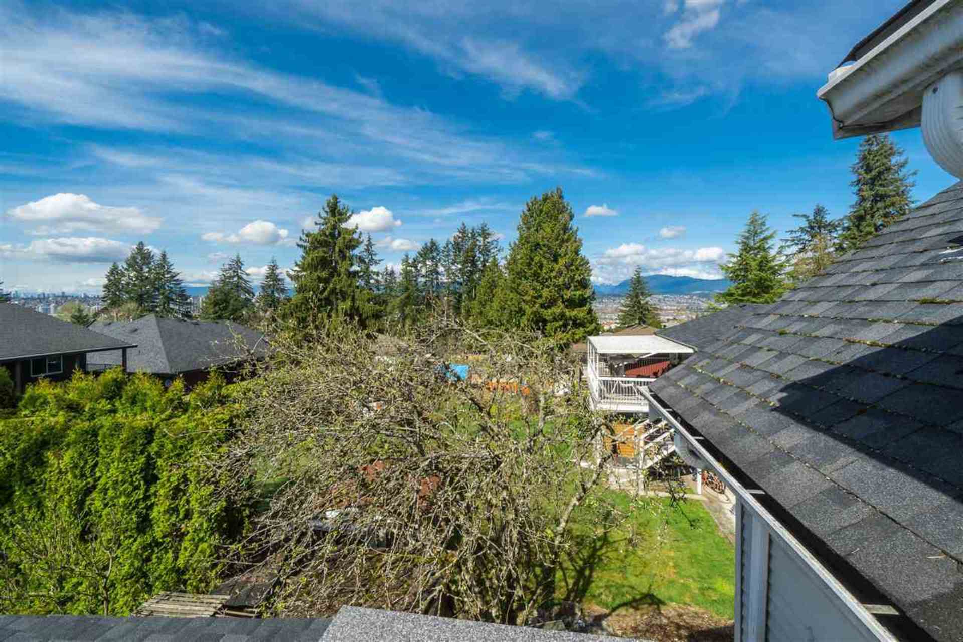 View from second level towards mountains at 9941 121a Street, Cedar Hills, North Surrey