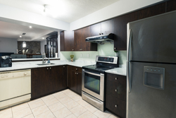5-kitchen-open-to-dining at 35 - 7533 140 Street, East Newton, Surrey