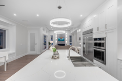 09-kitchen-to-great-room-with-chandeliers at 10916 162 Street, Fraser Heights, North Surrey