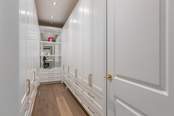 14-upper-level-showroom-inspired-walk-in-closet-with-extended-cabinetry at 13175 19a Avenue, Crescent Bch Ocean Pk., South Surrey White Rock