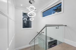 14-grand-staircase-with-designer-chandelier at 2235 153a Street, King George Corridor, South Surrey White Rock
