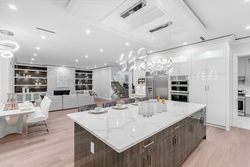 7-entertaining-island-with-designer-cabinetry-and-eating-area at 2235 153a Street, King George Corridor, South Surrey White Rock