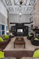 11-great-room-with-custom-ceiling-detail-and-floor-to-ceiling-stone-fireplace at 5615 121a Street, Panorama Ridge, Surrey