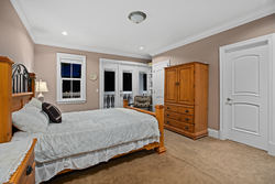 12-spacious-bedroom-on-the-main-level-with-ensuite-terrace-access at 5615 121a Street, Panorama Ridge, Surrey